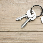 Key on wood background, FHA loan